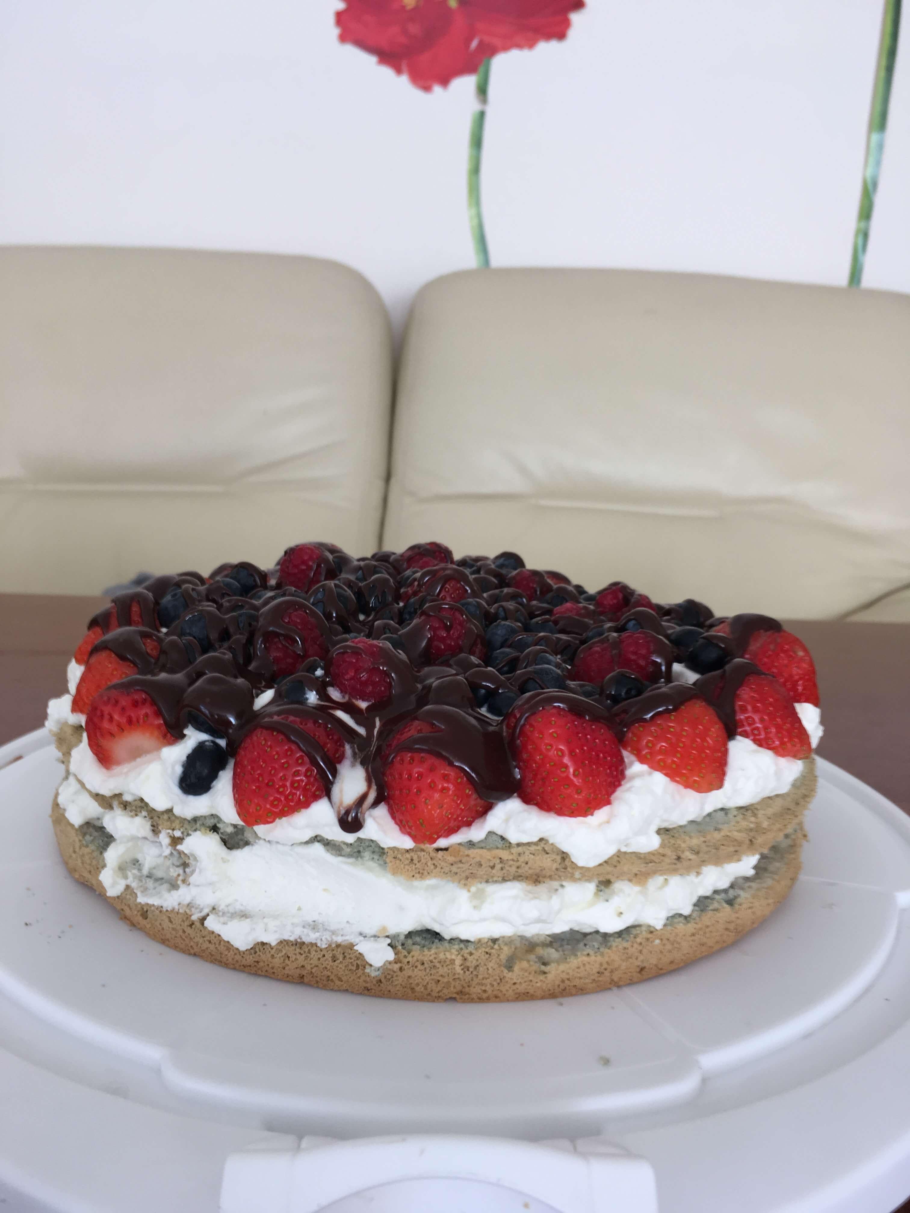Blue sponge cake with cream and fruit